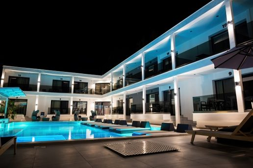 Modern villa with multiple lights and sun loungers in Asprovalta