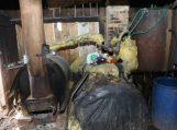 Girininkų k. aptiktas naminės degtinės fabrikėlis su jame besidarbavusiu degtindariu