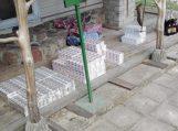 Traksėdžiuose aptiktas naminukės ir kontrabandinių cigarečių taškas